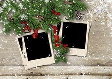 Christmas fir tree with polaroid-frame on wooden board Stock Photo
