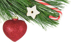 Christmas fir tree, red bauble and candy cane Royalty Free Stock Photos