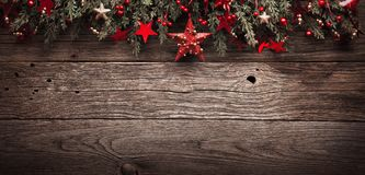 Christmas Fir Tree With Red Star On Wooden Background Royalty Free Stock Photography