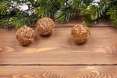Christmas fir tree with snow and baubles on rustic wooden board. With copy space Stock Photos