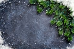 Christmas fir tree and snow. Over stone background. Top view with copy space for your greetings Stock Photo