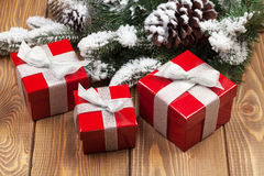 Christmas fir tree with snow and red gift boxes Stock Photo