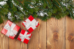 Christmas fir tree with snow and red gift boxes Royalty Free Stock Images