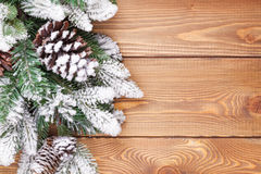 Christmas fir tree with snow on rustic wooden board Stock Photography