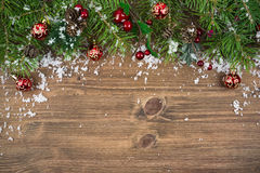 Christmas fir tree with snow on wooden background Royalty Free Stock Photography