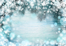 Christmas fir tree with snow on a wooden board. Christmas blue framework Stock Image