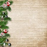 Christmas fir tree with snowfall and berries on a wooden board. Christmas wood background with branches, berries and decor, with place for photo and text, for Royalty Free Stock Photo