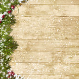Christmas fir tree with snowfall  on a wooden board. Christmas wooden vintage background  with space for text or photo and with decorations Royalty Free Stock Images