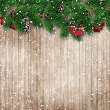 Christmas fir tree on snowy wooden background Stock Photo
