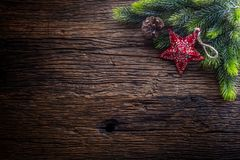 Christmas. Christmas fir tree with star and pine cone on rustic wooden table Royalty Free Stock Images