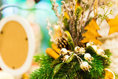 Christmas Fir Tree Toys Old wooden star hanging on branch Burning Candles, Boxes, Balls, Pine Cones, Walnuts, Branchesin Royalty Free Stock Images