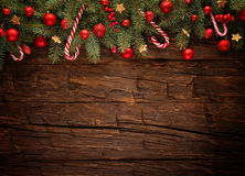 Free Christmas Fir Tree With Decoration On A Wooden Stock Images - 62186744