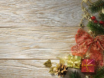 Christmas fir tree on wood texture. Royalty Free Stock Photography