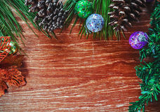 Christmas fir tree on wooden background Stock Photos