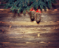 Christmas fir tree on wooden background. Christmas fir tree with decoration on dark wooden board, top view Royalty Free Stock Photography