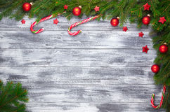 Christmas fir tree on wooden background Royalty Free Stock Images