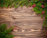 Christmas fir tree on wooden background Royalty Free Stock Photos