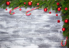 Christmas fir tree on wooden background Royalty Free Stock Photo