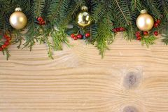 Christmas fir tree on wooden background Stock Photography