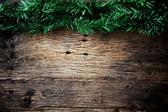 Christmas fir tree on a wooden Royalty Free Stock Image