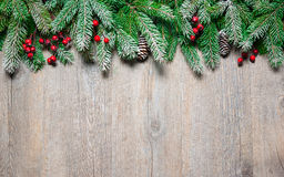 Christmas fir tree on a wooden board Stock Image