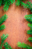 Christmas fir tree on a wooden board Royalty Free Stock Images
