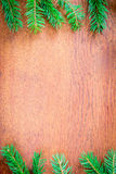 Christmas fir tree on a wooden board Royalty Free Stock Image