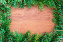 Christmas fir tree on a wooden board Royalty Free Stock Photo