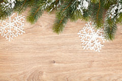 Christmas fir tree on wooden board Royalty Free Stock Photos