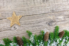 Christmas fir tree on a wooden board Royalty Free Stock Photos