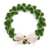 Christmas fir-tree wreath and glowing sparks. Christmas fir-tree wreath with glowing lights and pink bow. Golden shining sparks. White background. Realistic Stock Photo