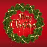Christmas fir-tree wreath and glowing sparks. Christmas wreath from real fir branches and holly glowing lights. Golden shining sparks. Golden inscription. Red Stock Images