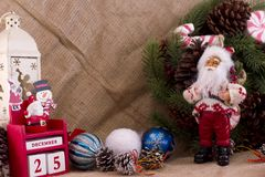 Christmas fir wreath with cones and candies, Santa Claus and cal Royalty Free Stock Photography