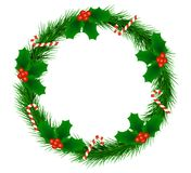 Christmas Fir Wreath with Holly Berries and Candy Canes. Wreath made of Christmas Tree fir Royalty Free Stock Image