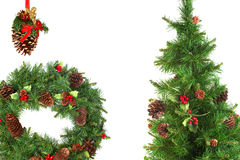Christmas fir wreath, pine cones and Christmas tree Stock Photos