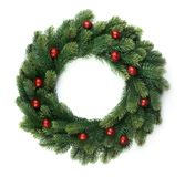 Christmas fir wreath. With red balls isolated on white background royalty free stock photography
