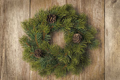 Christmas fir wreath on vintage wooden background, horizontal Stock Images