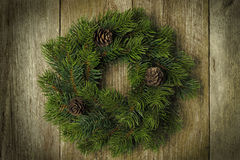 Christmas fir wreath on vintage wooden background, horizontal Royalty Free Stock Photography