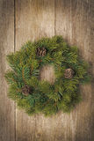 Christmas fir wreath on vintage wooden background Stock Photo