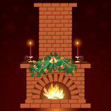 Christmas fireplace. With two candles Stock Photography