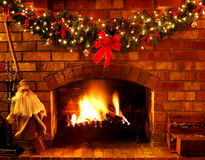 Christmas Fireplace. Log fire with Christmas garland and fairylights Stock Photography