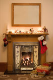 Christmas fireplace. Victorian style fireplace ready for Christmas royalty free stock photos