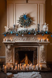 Christmas fireplace with candles and decorations Royalty Free Stock Image