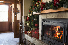 Christmas fireplace with christmas decorations in a restaurant Stock Photos