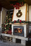 Christmas fireplace with decorated christmas tree Royalty Free Stock Photo