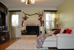 Christmas fireplace. Fireplace decorated for christmas in modern interior in white and red colors Stock Photography
