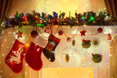Christmas Fireplace, Family Hanging Socks, Xmas Lights Decoration, Tree Branches Royalty Free Stock Photography