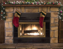 Christmas Fireplace Hearth and Stockings Landscape. Christmas stockings hanging over the fireplace hearth royalty free stock photography