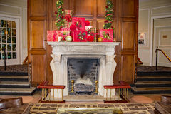 "A Christmas Fireplace at the ""The Hotel Roanoke"". Roanoke, VA - November 28th: A beautiful large fireplace in the lobby of ""Hotel Roanoke stock photography"