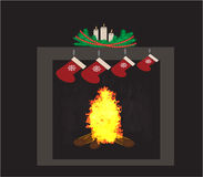 Christmas fireplace. With stockings and candles Stock Photography